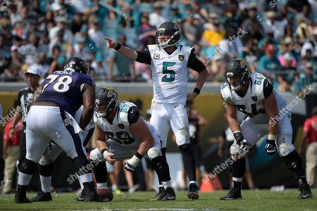 Tyler Shatley, Christopher Reed, Michael Pierce, Blake Bortles. Jacksonville Jaguars offensive guard Tyler Shatley (69) and guard Christopher Reed (64) line up in front of Baltimore Ravens defensive tackle Michael Pierce (78) as Jaguars quarterback Blake Bortles (5) calls out signals during the second half of an NFL football game in Jacksonville, Fla., . The Ravens won 19-17