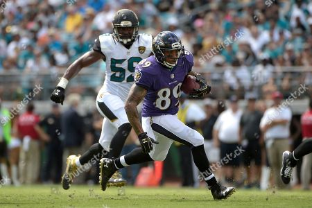 Steve Smith, Arthur Brown. Baltimore Ravens wide receiver Steve Smith (89) runs after catching a pass in front of Jacksonville Jaguars linebacker Arthur Brown (59) during the first half of an NFL football game in Jacksonville, Fla