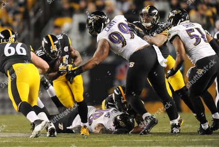Josh Harris, Chris Canty. Pittsburgh Steelers running back Josh Harris (40) tries to get past Baltimore Ravens defensive end Chris Canty (99) and Brandon Williams in the first quarter an NFL wildcard playoff football game against the Baltimore Ravens, in Pittsburgh