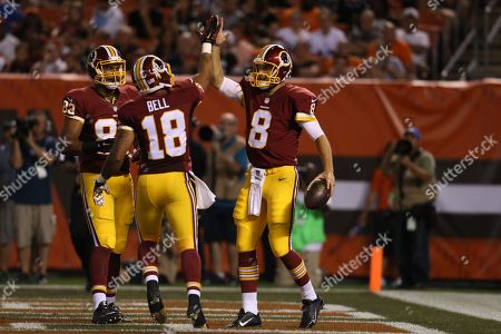 Kirk Cousins, Reggie Bell. Washington Redskins quarterback Kirk Cousins (8) is congratulated by Reggie Bell (18) after scrambling in for a 4-yard touchdown in the second quarter of an NFL preseason football game against the Cleveland Browns, in Cleveland