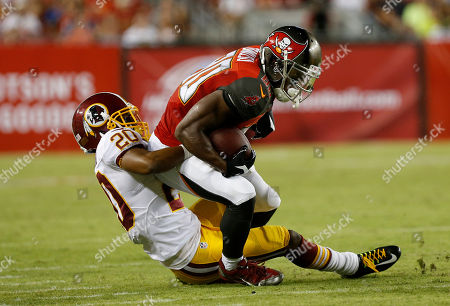 Tampa Bay Buccaneers wide receiver Chris Owusu (80) is stopped by Washington Redskins cornerback Richard Crawford (20) during the third quarter of an NFL preseason football game, in Tampa, Fla