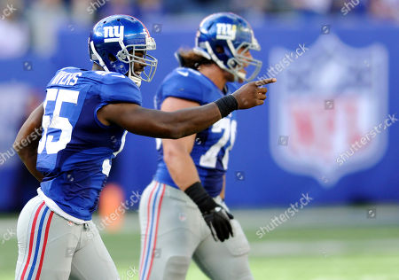 New York Giants linebacker Keith Rivers reacts during the second half of an NFL football game against the Washington Redskins, in East Rutherford, N.J