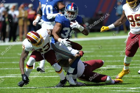 Washington Redskins free safety DeAngelo Hall (23) tackles New York Giants' Shane Vereen (34) during the first half of an NFL football game, in East Rutherford, N.J