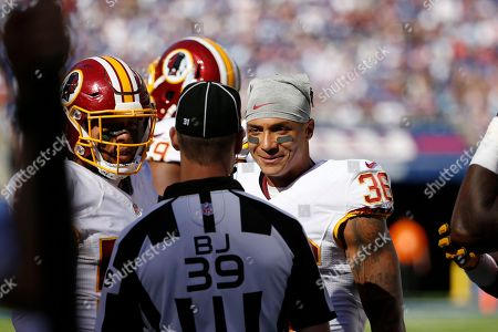 Stock Image of Washington Redskins defensive back Su'a Cravens (36) talks to an official during the second half of an NFL football game against the New York Giants, in East Rutherford, N.J