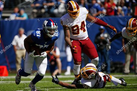 New York Giants wide receiver Sterling Shepard (87) runs past Washington Redskins' DeAngelo Hall (23) during the first half of an NFL football game, in East Rutherford, N.J