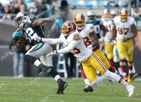 Jerricho Cotchery, Chris Culliver, Dashon Goldson. Carolina Panthers' Jerricho Cotchery (82) tries to run away from Washington Redskins' Chris Culliver (29) and Dashon Goldson (38) during the first half of an NFL football game in Charlotte, N.C., . The Panthers won 44-16