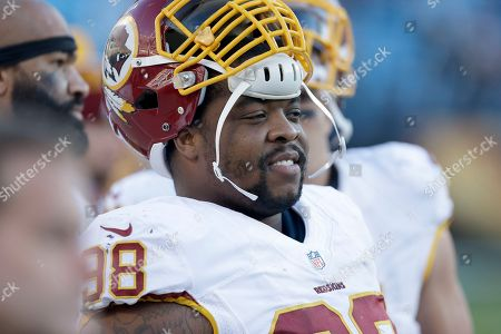 Washington Redskins' Terrance Knighton (98) on the sidelines during the second half of an NFL football game against the Carolina Panthers in Charlotte, N.C., . The Panthers won 44-16