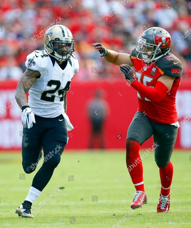 Kyle Wilson, Sterling Moore. New Orleans Saints defensive back Kyle Wilson (24) and Tampa Bay Buccaneers cornerback Sterling Moore (26) battle during a punt in an NFL football game, in Tampa, Fla