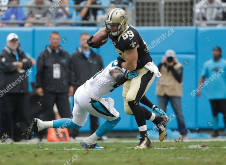 Josh Hill, Roman Harper. New Orleans Saints' Josh Hill (89) is hit by Carolina Panthers' Roman Harper (41) in the first half of an NFL football game in Charlotte, N.C