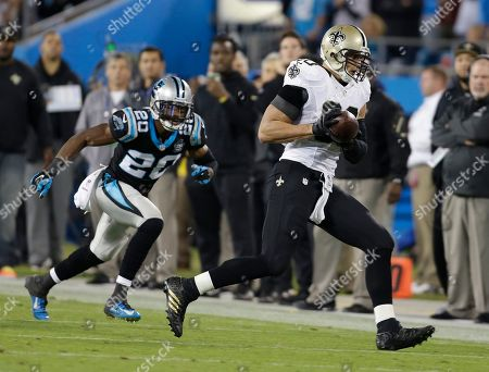 Jimmy Graham,Antoine Cason. New Orleans Saints' Jimmy Graham, right, catches a pass Carolina Panthers' Antoine Cason, left, defends in the first half of an NFL football game in Charlotte, N.C