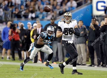 Jimmy Graham, Antoine Cason. New Orleans Saints' Jimmy Graham (80) watches a pass come his way as Carolina Panthers' Antoine Cason (20) prepares to defend during the second half of an NFL football game in Charlotte, N.C., . The Saints won 28-10