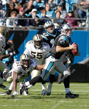 Jimmy Clausen, Jonathan Vilma, Danny Clark. Carolina Panthers' Jimmy Clausen (2) scrambles as New Orleans Saints' Jonathan Vilma (51) and Danny Clark (55) pursue in the first half of an NFL football game in Charlotte, N.C