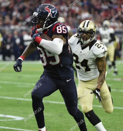 Houston Texans wide receiver Nate Washington (85) makes a play against New Orleans Saints defensive back Kyle Wilson (24) during the third quarter of an NFL football game, in Houston