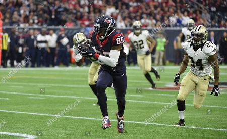 Nate Washington, Kyle Wilson. Houston Texans wide receiver Nate Washington (85) runs for a first down after catching a pass as New Orleans Saints defensive back Kyle Wilson (24) pursues him during the third quarter of an NFL football game, in Houston