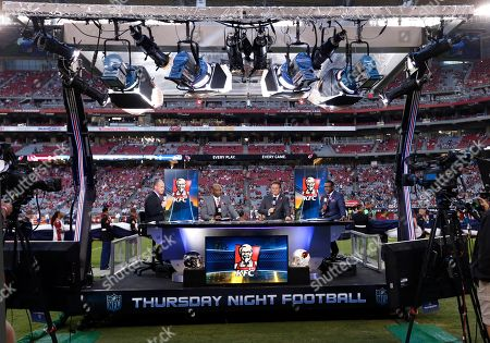 Stock Photo of Rich Eisen, Dion Sanders, Steve Mariucci, Michael Irvin. The NFL Network Thursday Night Football live crew from left, Rich Eisen, Dion Sanders, Steve Mariucci and Michael Irvin talk prior to a NFL football game against the Arizona Cardinals and the Seattle Seahawks, in Glendale, Ariz