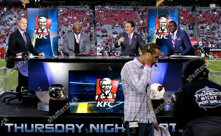 Rich Eisen, Dion Sanders, Steve Mariucci, Michael Irvin. The NFL Network Thursday Night Football live crew from left, Rich Eisen, Dion Sanders, Steve Mariucci and Michael Irvin talk prior to a NFL football game against the Arizona Cardinals and the Seattle Seahawks, in Glendale, Ariz
