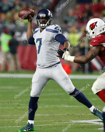 Seattle Seahawks quarterback Tarvaris Jackson (7) throws against the Arizona Cardinals during the second half of an NFL football game, in Glendale, Ariz