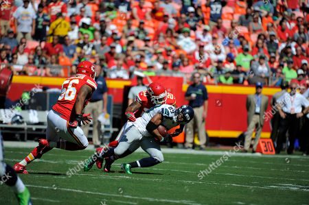 Doug Baldwin, Steven Nelson. Seattle Seahawks wide receiver Doug Baldwin (89) is tackled by Kansas City Chiefs defensive back Steven Nelson (20) during the first half of an NFL preseason football game in Kansas City, Mo