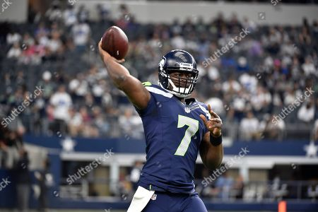 Stock Picture of Seattle Seahawks quarterback Tarvaris Jackson (7) throws during warm ups before an NFL football game against the Dallas Cowboys, in Arlington, Texas