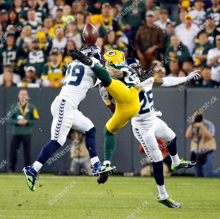 Seattle Seahawks' Richard Sherman (25) is called for pass interference on this pass to Green Bay Packers' James Jones during the first half of an NFL football game, in Green Bay, Wis. Also pictured is Earl Thomas (29
