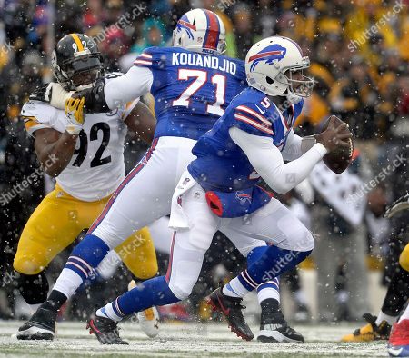 Tyrod Taylor, James Harrison. Buffalo Bills quarterback Tyrod Taylor (5) scrambles out of the pocket as tackle Cyrus Kouandjio (71) blocks against Pittsburgh Steelers linebacker James Harrison (92) during the first half of an NFL football game, in Orchard Park, N.Y