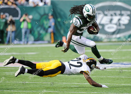 New York Jets running back Chris Ivory (33) jumps over Pittsburgh Steelers' William Gay (22) during the first half of an NFL football game, in East Rutherford, N.J