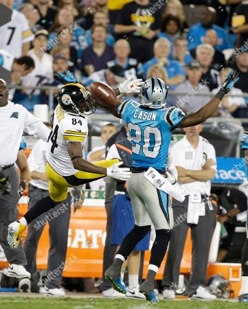 Antonio Brown, Antoine Cason. Pittsburgh Steelers' Antonio Brown (84) tries to regain his balance and the catch as Carolina Panthers' Antoine Cason (20) breaks up the play during the second half an NFL football game in Charlotte, N.C., . The Steelers won 37-19