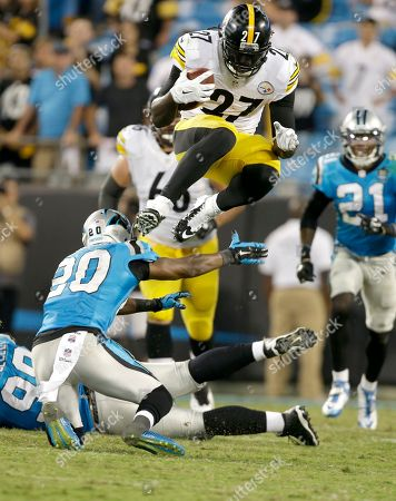 LeGarrette Blount, Antoine Cason. Pittsburgh Steelers' LeGarrette Blount (27) hurdles over Carolina Panthers' Antoine Cason (20) during the second half an NFL football game in Charlotte, N.C., . The Steelers won 37-19