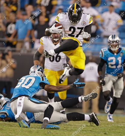 LeGarrette Blount, Antoine Cason. Pittsburgh Steelers' LeGarrette Blount (27) leaps over Carolina Panthers' Antoine Cason (20) during the second half of an NFL football game in Charlotte, N.C., . The Steelers won 37-19