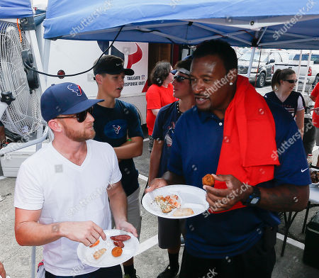 Eric Ladin,Willie Gault. Houstonian and Hollywood actor Eric Ladin, left, and former NFL player and NFL Network announcer Willie Gault judgedishes from the HBO Hard Knocks Tailgate Competition during an NFL football training camp at the Methodist Training Center on in Houston