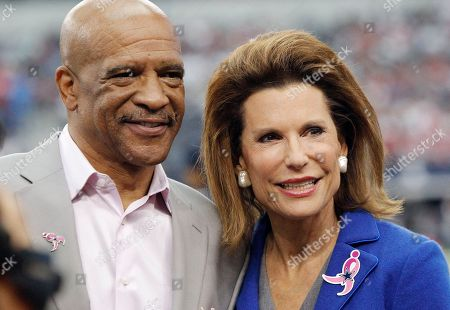 Drew Pearson, Nancy Brinker. Former Dallas Cowboys Drew Pearson and Susan G. Komen Founder Nancy Brinker are seen before the start of the first half of an NFL football game against the Houston Texans, in Arlington, Texas. Dallas won 20-17 in overtime