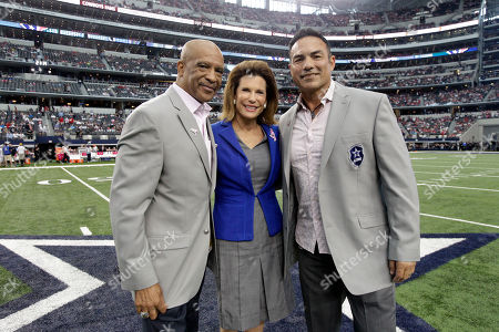 Drew Pearson, Nancy Brinker, Tony Cassilas. L to R) Former Dallas Cowboy Drew Pearson, Susan G. Komen Founder Nancy Brinker and former Dallas Cowboy Tony Casillas pose for a photo before the start of the first half of an NFL football game against the Houston Texans, in Arlington, Texas. Dallas won 20-17 in overtime
