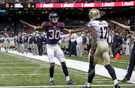 Josh Morgan, Kevin Johnson. Houston Texans cornerback Kevin Johnson (30) reacts after an incomplete pass to New Orleans Saints wide receiver Josh Morgan (17) in the first half of a preseason NFL football game in New Orleans
