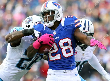 C.J. Spiller, Jordan Babineaux. Buffalo Bills running back C.J. Spiller (28) is tackles by Tennessee Titans strong safety Jordan Babineaux (26)during the first half of an NFL football game in Orchard Park, N.Y