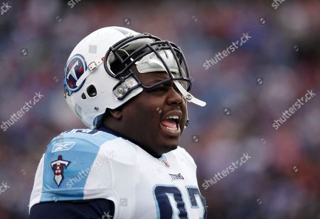Tennessee Titans' Shaun Smith yells to his teammates from the sideline during the first quarter of an NFL football game against the Buffalo Bills in Orchard Park, N.Y