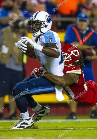 Tennessee Titans wide receiver Hakeem Nicks (14) is tackled by Kansas City Chiefs cornerback Jamell Fleming (30) during an NFL game on at Arrowhead Stadium in Kansas City, Mo
