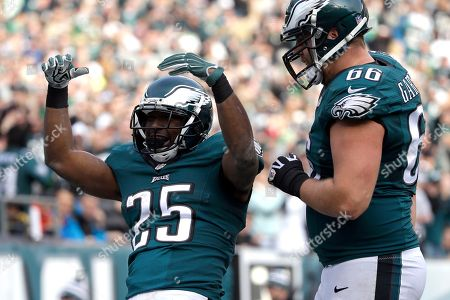 Philadelphia Eagles' LeSean McCoy, left, celebrates with Andrew Gardner after McCoy's touchdown during the first half of an NFL football game against the Tennessee Titans, in Philadelphia