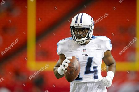 Tennessee Titans wide receiver Hakeem Nicks (14) runs with the ball after making a catch while he warms up for an NFL game against the Atlanta Falcons at the Georgia Dome in Atlanta, Ga. on