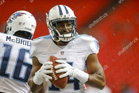Tennessee Titans wide receiver Hakeem Nicks (14) smiles after making a catch while warming up for an NFL game against the Atlanta Falcons at the Georgia Dome in Atlanta, Ga. on