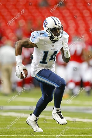 Tennessee Titans wide receiver Hakeem Nicks (14) runs with the ball after making a catch as he warms up during an NFL game against the Atlanta Falcons at the Georgia Dome in Atlanta, Ga. on