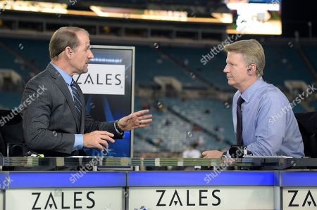 Bill Cowher, Phil Simms. Thursday Night Football sportscasters Bill Cowher, left, and Phil Simms talk on the set on the field before an NFL football game between the Jacksonville Jaguars and the Tennessee Titans in Jacksonville, Fla