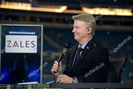 Thursday Night Football sportscaster Phil Simms broadcasts from the set on the field before an NFL football game between the Jacksonville Jaguars and the Tennessee Titans in Jacksonville, Fla