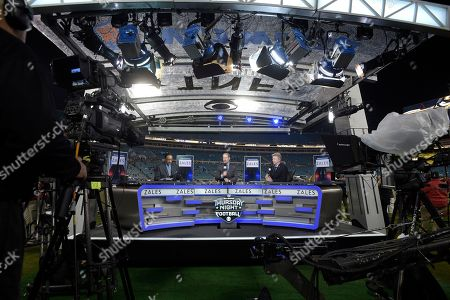 James Brown, Bill Cowher, Phil Simms. Thursday Night Football sportscasters James Brown, left, Bill Cowher, center, and Phil Simms broadcast from the set on the field before an NFL football game between the Jacksonville Jaguars and the Tennessee Titans in Jacksonville, Fla
