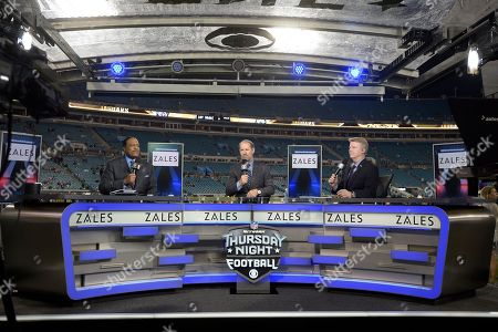 Bill Cowher, Phil Simms, James Brown. Thursday Night Football sportscasters James Brown, left, Bill Cowher, center, and Phil Simms broadcast from the field before an NFL football game between the Jacksonville Jaguars and the Tennessee Titans in Jacksonville, Fla