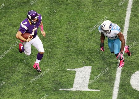 Christian Ponder, Jordan Babineaux. Minnesota Vikings quarterback Christian Ponder, left, runs from Tennessee Titans safety Jordan Babineaux during the second half of an NFL football game, in Minneapolis