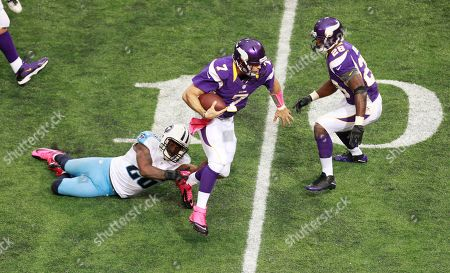 Christian Ponder, Jordan Babineaux, Adrian Peterson. Minnesota Vikings quarterback Christian Ponder (7) tries to break a tackle by Tennessee Titans safety Jordan Babineaux during the second half of an NFL football game, in Minneapolis. Minnesota Vikings running back Adrian Peterson, right, looks on