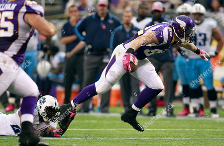 Kyle Rudolph, Jordan Babineaux. Minnesota Vikings tight end Kyle Rudolph, right, tries to break a tackle by Tennessee Titans safety Jordan Babineaux, left, after making a reception during the first half of an NFL football game, in Minneapolis