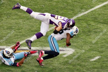 Toby Gerhart, Jordan Babineaux, Michael Griffin. Minnesota Vikings running back Toby Gerhart (32) dives over Tennessee Titans strong safety Jordan Babineaux (26) as he gains yardage during the second half of an NFL football game, in Minneapolis. At left is Titans free safety Michael Griffin (33). The Vikings won 30-7