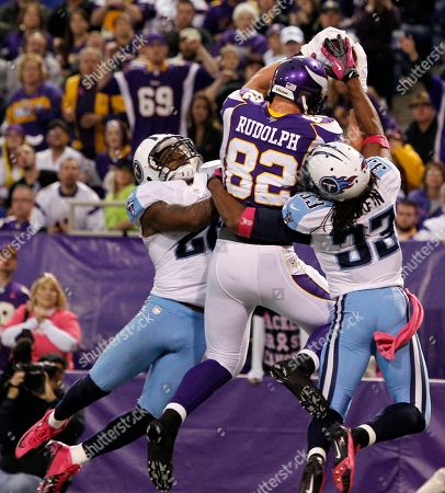 Kyle Rudolph, Jordan Babineaux, Michael Griffin. Minnesota Vikings tight end Kyle Rudolph (82) catches a 15-yard touchdown pass between Tennessee Titans' Jordan Babineaux, left, and Michael Griffin, right, during the second half of an NFL football game, in Minneapolis