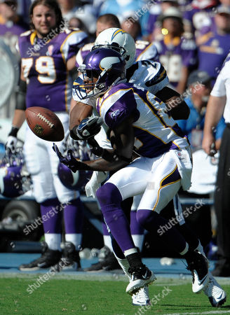 Bernard Berrian, Antoine Cason. Minnesota Vikings wide receiver Bernard Berrian (87) tries to make a catch in front of San Diego Chargers defensive back Antoine Cason (20) during an NFL football game in San Diego